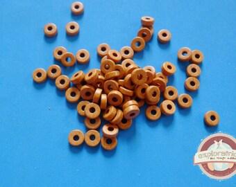 100 beads ethnic 2x6mm ochre mustard yellow ceramic washers