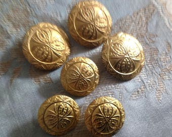 Golden set of six metal buttons, two sizes
