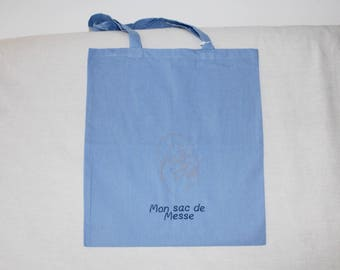 Tote bag blue and embroidery mass.