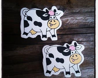set of 2 wooden black and white cows