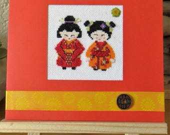 Hand embroidered card: small kokeshis in Orange