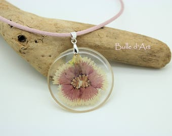 Resin necklace with pendant and pink flower