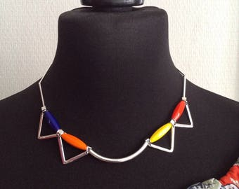 Choker necklace with bright beads and silver metal tubes