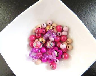 Set of 50 beads in pink-orange