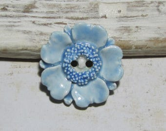 Pastel blue anemone ceramic flower button