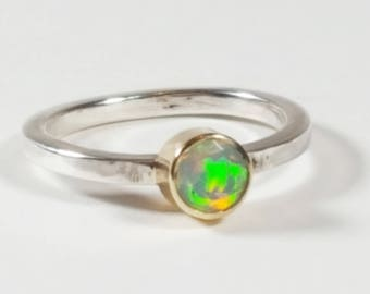 Absolutely stunning ethiopian opal set in 9ct gold on a sterling silver band ring