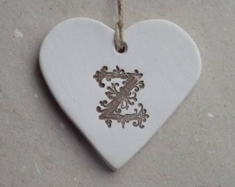 Diffuser essential oil, ceramic heart personalized with initial Z Brown on white background