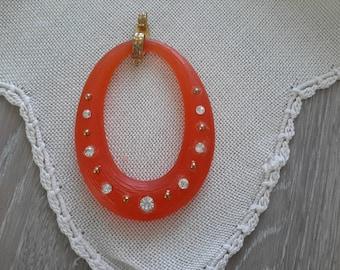 medium acrylic and rhinestone Oval Pendant