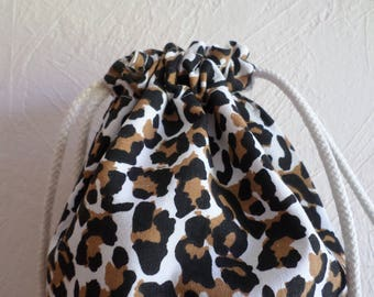 Brown, ecru and black pouch with spots
