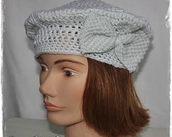 Pearl gray crochet beret.