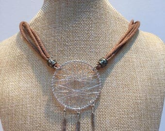 Necklace dream catcher and feathers