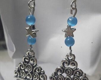 Earrings in turquoise blue cat eye beads