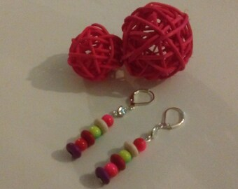 Dangling earrings with stud earrings in silver and pearls