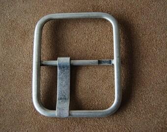 Large loop for belt or bag, metal, silver color.