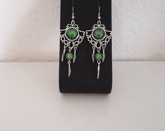 Feather and green cabochon earrings