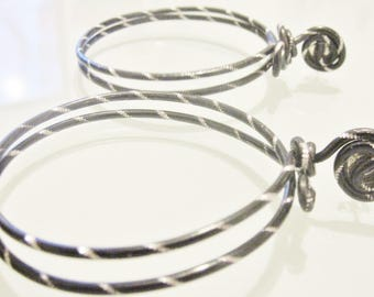 Black hoops and silver twice for women and teens with stud earrings