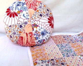 Cushion round patchwork floral in pastel colors