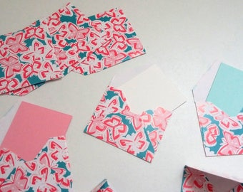 Set of small blue envelopes with pink butterflies