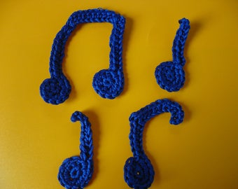 set of crocheted music notes, made of blue cotton