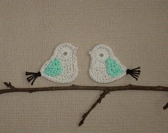 a couple of ecru, green and chocolate birds crochet