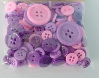 set of 152 buttons of various sizes pink mauve and purple