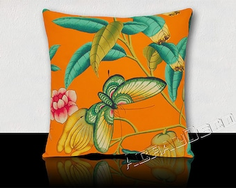 DESIGNER cushion large Butterfly /fruit and exotic foliage. Turquoise/yellow/green Emerald/Fuchsia/black on a Tangerine background.