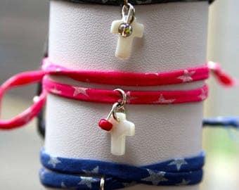 Religious tie bracelet, mother of Pearl cross