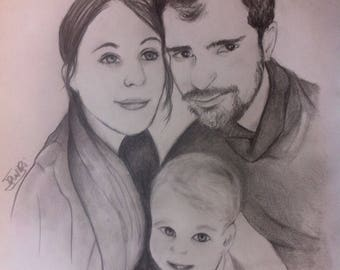 Portrait drawing of couple and their baby