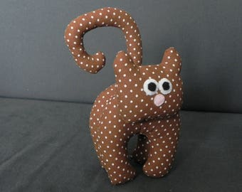 Little Brown cat with white polka dots
