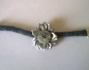 Wool bracelet made by knitting.