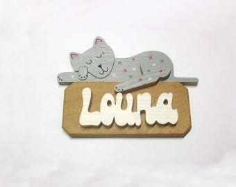 Louna in real solid wood with a sleeping cat