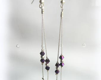 Very long and elegant earrings with Crystal beads