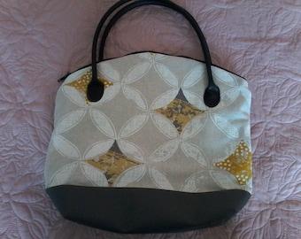 Geometric patterned hand bag