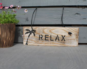 Sign skated ornamental wood