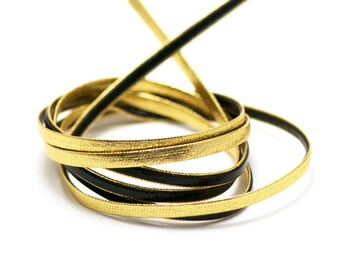 5 meters of synthetic leather 4 x 1 mm black/gold