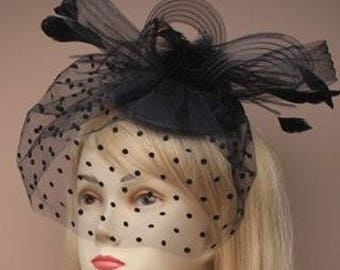 Black hatinator with black feathers