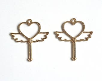 Set of 2 gold metal wings and heart key pendant