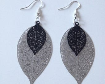 Pair of silver and black leaf earrings