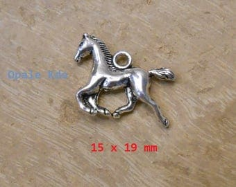 Charm or pendant silver tone metal horse