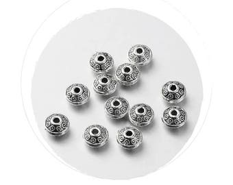 Set of 10 beads, silver, 6.5 x 4 mm, hole 1 mm