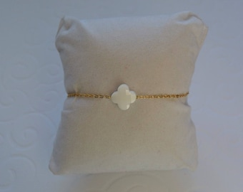 Opaque white clover bracelet on gold chain