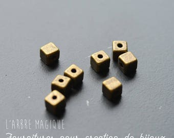 cubes are 10 metal bronze spacer 4 mm size