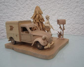 Tour the 2CV van factor. Decorative figurines made of wood.