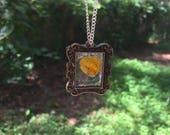 Antique framed wildflower...