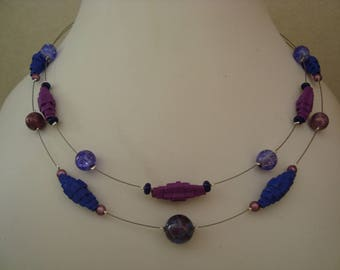 Necklace made of corrugated cardboard and glass beads