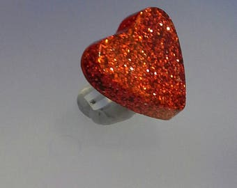 Adjustable ring with a red glitter resin heart