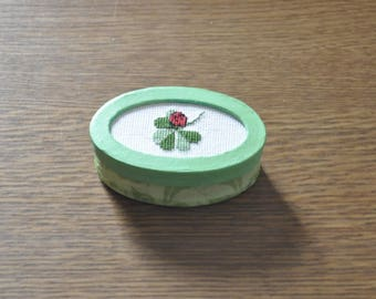 Green box with clover and Ladybug cross stitch