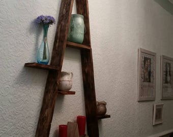 Mountain display shelving triangular shape made from recycled pallet wood