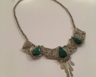 Desirable silver tone vintage necklace with green stones