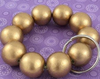 Gold wood bead bracelet keychain